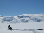 photo of researchers setting up a gps station on flask glacier