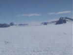 This image, from AMIGOS-2, looks up Flask Glacier towards where the researchers were working on AMIGOS-3. Crevasses are visible near the right, bottom, and left edges of the image.