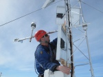 researcher climbs a weather station